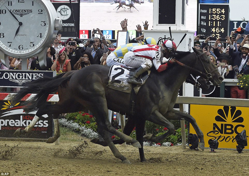 Cloud Computing edged out 2yo champ Classic Empire for Preakness title.